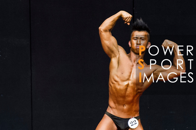 A bodybuilder competes in the Junior Men's Bodybuilding 70kg & below category during the 2016 Hong Kong Bodybuilding Championships on 12 June 2016 at Queen Elizabeth Stadium, Hong Kong, China. Photo by Lucas Schifres / Power Sport Images