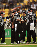 Black Caps players congratulate Daniel Vettori for dismissing Sachin Tendulkar during the 2nd ODI cricket match between the New Zealand Black Caps and India at Westpac Stadium, Wellington, New Zealand on Friday, 6 March 2009. Photo: Dave Lintott / lintottphoto.co.nz