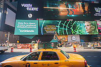Advertising for J.J. Abrams' Star Wars: The Force Awakens, which will premiere in two weeks, on a giant LED screen and on a taxicab in Times Square in New York on Friday, December 4, 2015. With the release of numerous trailers, licensed merchandise and now in-your-face advertising the Disney Co. promotional juggernaut is amping up for the blockbuster release.(© Richard B. Levine)