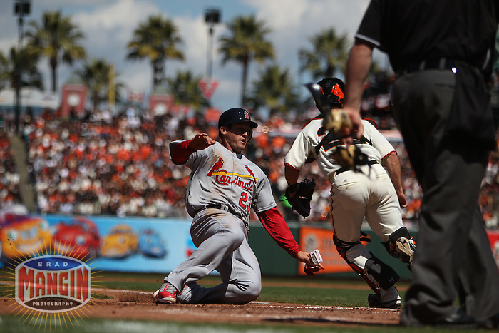 SAN FRANCISCO - APRIL 8:  David Freese of the St. Louis Cardinals slides home safely against the San Francisco Giants during Opening Day at AT&T Park on April 8, 2011 in San Francisco, California. Photo by Brad Mangin