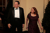 David Cohen, chairman of the University of Pennsylvania and former executive vice president of Comcast Corp., left, and Rhonda Cohen arrive to a state dinner hosted by U.S. President Barack Obama and U.S. First Lady Michelle Obama in honor of French President Francois Hollande at the White House in Washington, D.C., U.S., on Tuesday, Feb. 11, 2014. Obama and Hollande said the U.S. and France are embarking on a new, elevated level of cooperation as they confront global security threats in Syria and Iran, deal with climate change and expand economic cooperation. <br /> Credit: Andrew Harrer / Pool via CNP