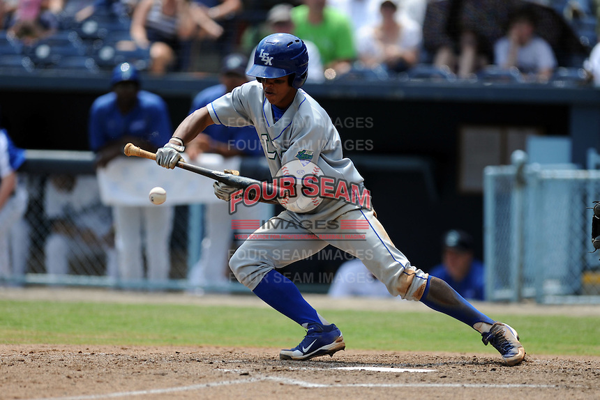Lexington Legends shortstop Raul Mondesi #2 lays down a bunt during a game against the Asheville Tourists at McCormick Field on June 16, 2013 in Asheville, North Carolina. The Tourists won the game 8-7. (Tony Farlow/Four Seam Images)