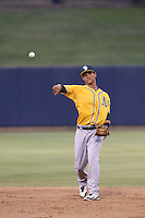 Carlos Hiciano (3) of the AZL Athletics throws during a game against the AZL Brewers at Maryvale Baseball Park on June 30, 2015 in Phoenix, Arizona. Brewers defeated Athletics, 4-2. (Larry Goren/Four Seam Images)