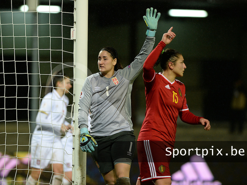 20151130 - LEUVEN ,  BELGIUM : Serbian goalkeeper Susanne Nilsson pictured with Belgian Sara Yuceil (r) during the female soccer game between the Belgian Red Flames and Serbia , the third game in the qualification for the European Championship in The Netherlands 2017  , Monday 30 November 2015 at Stadion Den Dreef  in Leuven , Belgium. PHOTO DAVID CATRY