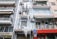 Pictured: Water has frozen on balconies of a block of flats in central Salonika, Greece. Monday 09 January 2017<br />Re: Severe cold weather affects Salonica in northern Greece