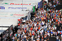 Sep 14, 2013; Charlotte, NC, USA; Fans surround the pits of NHRA funny car drivers John Force and Courtney Force during qualifying for the Carolina Nationals at zMax Dragway. Mandatory Credit: Mark J. Rebilas-