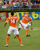 Houston Dynamo midfielder Ricardo Clark passes to Houston Dynamo midfielder Dwayne De Rosario. Houston Dynamo tied Colorado Rapids 3-3 at Robertson Stadium in Houston, TX on October 14, 2006.