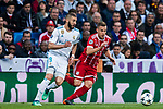 Joshua Kimmich of FC Bayern Munich fights for the ball with Karim Benzema of Real Madrid during the UEFA Champions League Semi-final 2nd leg match between Real Madrid and Bayern Munich at the Estadio Santiago Bernabeu on May 01 2018 in Madrid, Spain. Photo by Diego Souto / Power Sport Images