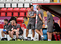 Lincoln City manager Danny Cowley (stood left) and Lincoln City's assistant manager Nicky Cowley<br /> <br /> Photographer Chris Vaughan/CameraSport<br /> <br /> Football Pre-Season Friendly - Lincoln City v Sheffield Wednesday - Saturday July 13th 2019 - Sincil Bank - Lincoln<br /> <br /> World Copyright © 2019 CameraSport. All rights reserved. 43 Linden Ave. Countesthorpe. Leicester. England. LE8 5PG - Tel: +44 (0) 116 277 4147 - admin@camerasport.com - www.camerasport.com