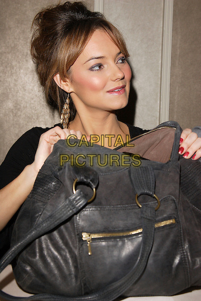 KARA TOINTON.Mad Hatters Tea Party - Annual event for children of London put on by the London Taxi Drivers Fund for Underprivilieged Children, Grosvenor House Hotel, Park Lane, London, England, January 20th 2008.half length sitting big black bag handbag.CAP/ROS.©Steve Ross/Capital Pictures