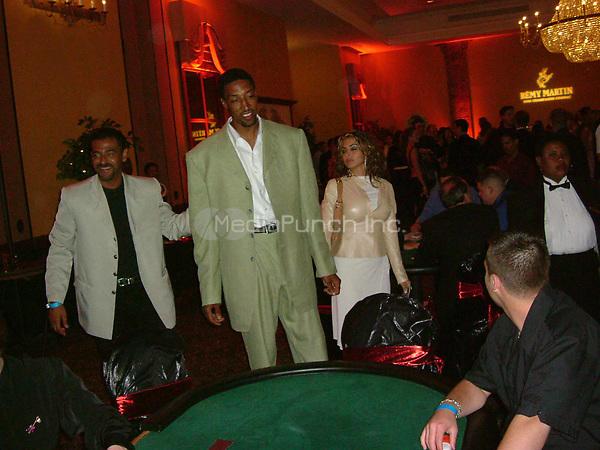 MIAMI BEACH, FL - OCTOBER 3: EXCLUSIVE COVERAGE - Scotti Pippen and wife Larsa Pippen TJ golf classic  in  Miami Beach 2003<br /><br />People:  Scotti Pippen and wife Larsa Pippen<br /><br />Transmission Ref:  FLXX<br /><br />Credit: Hoo-Me.com/MediaPunch