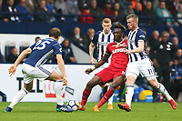 Tammy Abraham of Swansea City is challenged by Craig Dawson and Chris Brunt of West Bromwich Albion during the Premier League match between Swansea City and West Bromwich Albion at the Hawthorns Stadium, Birmingham, England, UK. Saturday 07 April 2018