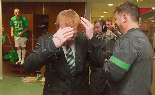 21.04.2013 Glasgow, Scotland. Neil Lennon tries to avoid the players in the dressing room after the Scottish Premier League game between Celtic and Inverness Caledonian Thistle from Celtic Park.