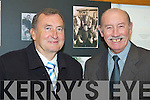 GOOD FRIENDS: Friends Ted Fitzgerald and Tommy O'Connor enjoying the Mitchels Regeneration Photography Exhibition at the Kerry County Library on Tuesday. .