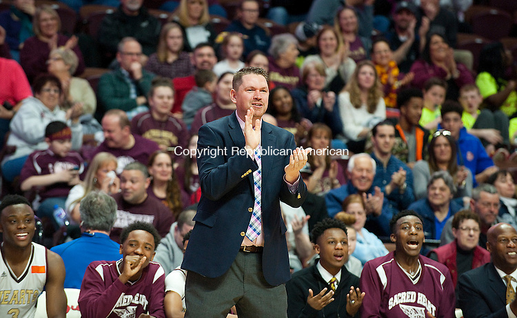 UNCASVILLE, CT--- -031916JS35-Sacred Heart head coach is all smiles in the closing minutes of their 101-49 win over Notre Dame-Fairfield to capture the Class M  state championship Saturday at Mohegan Sun Arena. <br /> Jim Shannon Republican-American<br /> n