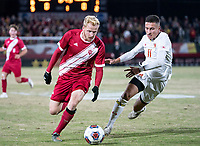 COLLEGE PARK, MD - NOVEMBER 15: Malcolm Johnson #11 of Maryland defends against Simon Waever #3 of Indiana during a game between Indiana University and University of Maryland at Ludwig Field on November 15, 2019 in College Park, Maryland.