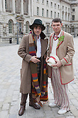 "Two Sci-fi fans dressed as ""The Doctor"" from Doctor Who. About 100 Science Fiction fans dressed up as their favourite characters and gathered in the courtyard of Somerset House to head off for the 4th Sci-Fi London Annual Costume Parade. The parade was organised by Sci-Fi London 14, the London International Festival of Science Fiction and Fantastic Film. The film festival runs until 4 May 2014."
