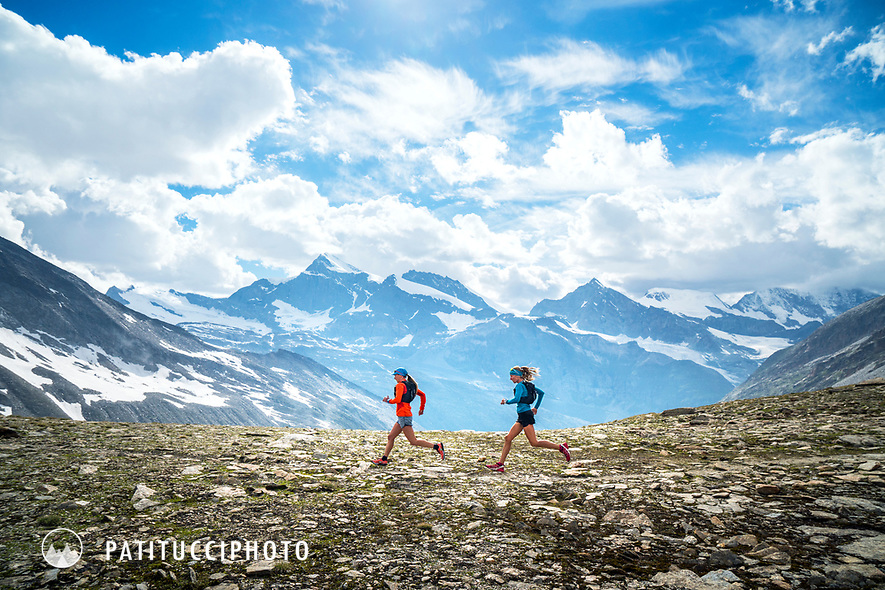 Two trail runners in the Ofental, above Saas Almagell, Switzerland