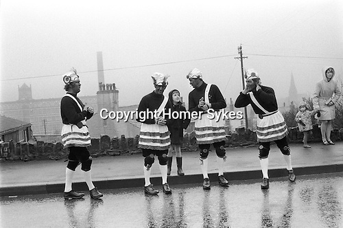 Britannia Coconut Dancers. Bacup, Lancashire. 1972 Mr Richard (Dick) 	Shufflebottom, Mr Derek Pilling, Stuart talking to his father Mr John Daley and Mr Keith Dawson made up part of the team of eight 	dancers.