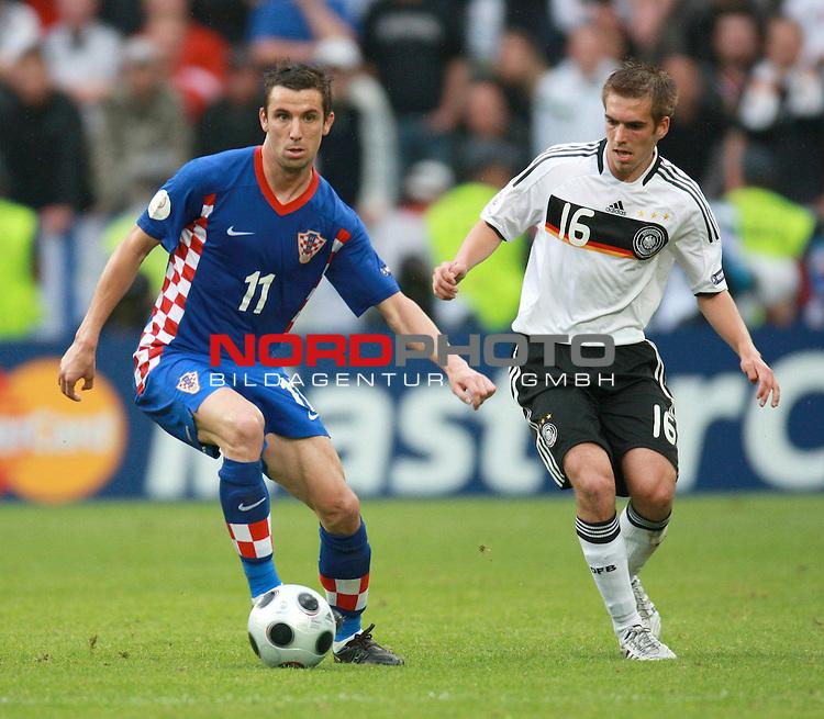 UEFA Euro 2008 Group B Klagenfurt - W&ouml;rthersee Match 11  Stadion Woerthersee<br /> Kroatien ( CRO ) - Deutschland ( GER ) 2:1 ( 1:0)<br /> <br /> Darijo Srna ( Croatia / Mittelfeldspieler / Midfielder / Shakhtar Donetsk #11 ) Philipp Lahm ( Germany  / Verteidiger / Defender / Bayern Muenchen #16) <br /> <br /> Foto &copy; nph (  nordphoto  )<br /> <br /> <br /> <br />  *** Local Caption ***