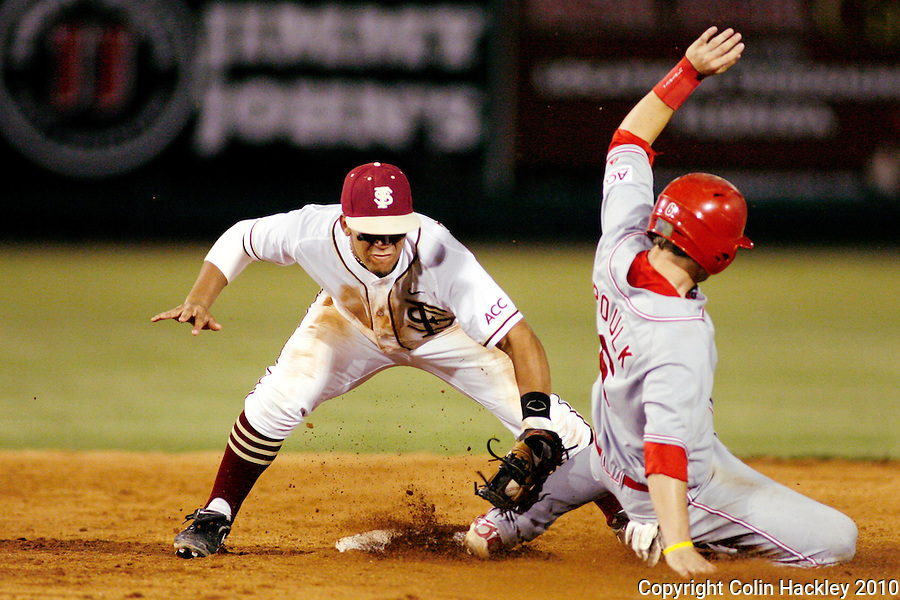 TALLAHASSEE, FL 5/14/10-FSU-NC STATE BASE10 CH-Florida State's Devon Travis tags N.C. State' s Dallas Poulk at second Friday at Dick Howser Stadium in Tallahassee. The Wolfpack downed the Seminoles 5-2...COLIN HACKLEY PHOTO