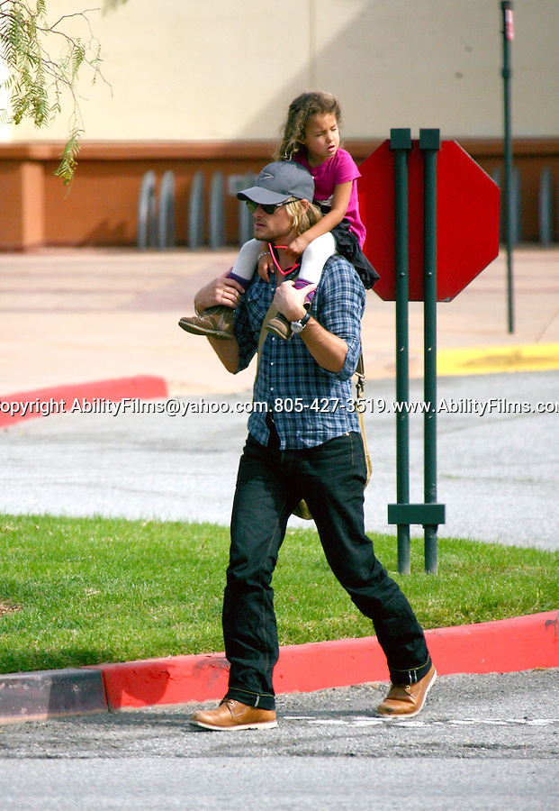 ...Feb 19th 2012 ..Gabriel Aubry  carrying his daughter Nahla Ariela on his shoulders taking her to the Zoo & a park with a fake elephant in Los Angeles. Nahla was having a great time wearing a bear mask & a cat shirt ...AbilityFilms@yahoo.com.805-427-3519.www.AbilityFilms.com.