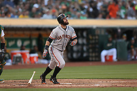 OAKLAND, CA - JULY 21:  Brandon Belt #9 of the San Francisco Giants hits a home run against the Oakland Athletics during the game at the Oakland Coliseum on Saturday, July 21, 2018 in Oakland, California. (Photo by Brad Mangin)