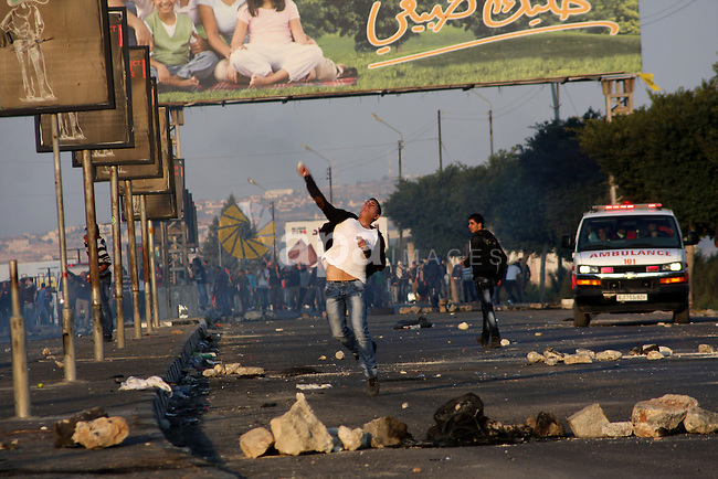 Palestinian protesters throw stones at Israeli soldiers during clashes in the West Bank city of Nablus, on November 20, 2012. The West Bank has witnessed almost daily demonstrations in support of Gaza Palestinians who have faced a week of Israeli air strikes against militants firing rockets at the Jewish state. Photo by Nedal Eshtayah