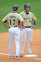 "22 April 2012:  FIU infielder Mike Martinez (40) speaks with FIU Head Coach Henry ""Turtle"" Thomas after reaching third as the University of Arkansas Little Rock Trojans defeated the FIU Golden Panthers, 7-6, at University Park Stadium in Miami, Florida."