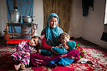 "Zahra Atayee, 25, Mokhtar, husband Freba, 5,<br /> Somaya, 3 1⁄2 Najma 7 months]] USED<br /> http://www.independent.co.uk/news/world/asia/as-nato-quits-afghanistan-new-violence-threatens -the-countrys-presidential-election-9194819.html<br /> ""I'd never been to school. The class was for nine months but I was pregnant and could not come. I learnt a bit about alphabets, but my pregnancy was an obstacle. I learnt how to prepare oral rehydration salts treatment. I feel like I'm blind; I can't read or write.<br /> ""There's no class here and I want to earn more.<br /> ""If there's a good election and if there's peace in the country I hope there are good opportunities. ""My husband does not have a job; he has not had a job for two years.<br /> ""He joined the military troops, but when the children were young they used to get sick and he left the job to help me care for them.<br /> ""It's too difficult to find work. There's corruption – if you do not know somebody you'll not be hired.<br /> ""I was in Iran living with my parents for three years ago. Ten years ago I moved back.<br /> ""There was fighting, that's why we escaped. The others were killed and out properties were burned. My grandfather and my uncle were killed by the Taliban. If the Taliban are not allowed to come back, if the international troops remain, I hope that we'll have a good future.<br /> ""I'm very concerned about the troops leaving Especially for the Hazara people because they are weak and they will not be able to fight. Of course, when the properties are looted and people are killed. Hazaras have been more oppressed.<br /> ""I hope my daughters will be educated and have more freedom. I hope they are not disallowed from advancing.<br /> Freba<br /> ""I'd like to work. I'd like to be a doctor because doctors give medicine to people.""]"