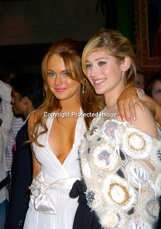 """Lindsay Lohan and Lizzy Caplan ..at a private screening of """"Mean Girls"""" on April 23, 2004 at the Loews Lincoln Square Theatre in New York City. ..Photo by Robin Platzer, Twin Images"""
