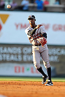 Second baseman Erison Mendez (9) of the Rome Braves plays a ground ball in a game against the Greenville Drive on Monday, June 15, 2015, at Fluor Field at the West End in Greenville, South Carolina. Greenville won, 9-3. (Tom Priddy/Four Seam Images)