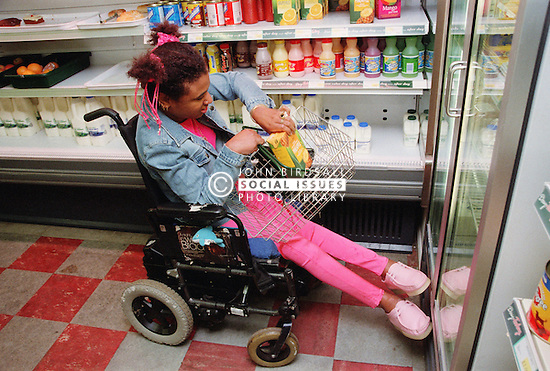 Young woman with Cerebral Palsy shopping in supermarket,