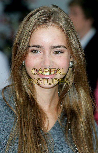 """LILY COLLINS .Attends the """"Angus, Thongs and Perfect Snogging"""" UK Film Premiere at the Empire Cinema, London, England, .July 16, 2008..portrait headshot smiling earrings .CAP/ROS.©Steve Ross/Capital Pictures"""