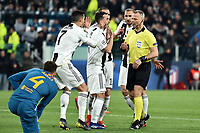 Cristiano Ronaldo and Miralem Pjanic of Juventus argue with referee Bjorn Kuipers during the Uefa Champions League 2018/2019 round of 16 second leg football match between Juventus and Atletico Madrid at Juventus stadium, Turin, March, 12, 2019 <br />  Foto Andrea Staccioli / Insidefoto