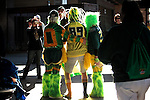 "010213--John Free and his wife Karna Jo of Olympia, pose for a picture with Brian Clemetson of Vancouver, middle, who calls himself,  .""Super Duck"", before the Oregon Ducks pep rally at Salt River Fields in  Scottsdale, Arizona. .Photo by Jaime Valdez"