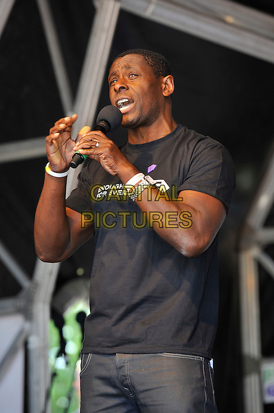David Harewood<br /> attending The Big IF, Hyde Park, London, England. <br /> 8th June 2013<br /> half length black t-shirt enough for every microphone  <br /> CAP/MAR<br /> &copy; Martin Harris/Capital Pictures