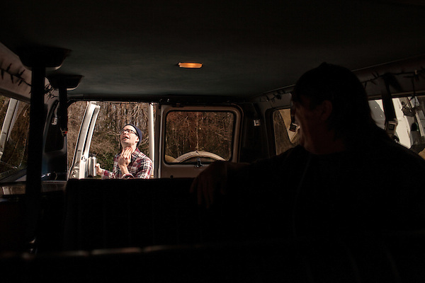 February 23, 2011. Along interstate 40 between Chapel Hill, NC and Nashville, TN.. Dan McGee, guitar and vocals, imitates a man with a hole in his throat while stopped at a rest area.. On tour with the Spider Bags while they play 2 shows and record a new album..