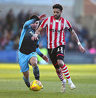 Lincoln City's Bruno Andrade battles with Stevenage's Ilias Chair<br /> <br /> Photographer Andrew Vaughan/CameraSport<br /> <br /> The EFL Sky Bet League Two - Lincoln City v Stevenage - Saturday 16th February 2019 - Sincil Bank - Lincoln<br /> <br /> World Copyright © 2019 CameraSport. All rights reserved. 43 Linden Ave. Countesthorpe. Leicester. England. LE8 5PG - Tel: +44 (0) 116 277 4147 - admin@camerasport.com - www.camerasport.com