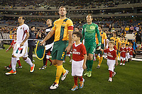 MELBOURNE, 11 JUNE 2013 - Lucas NEILL leads the Australian team onto the field for their Round 4 FIFA 2014 World Cup qualifier match between Australia and Jordan at Etihad Stadium, Melbourne, Australia. Photo Sydney Low for Zumapress Inc. Please visit zumapress.com for editorial licensing. *This image is NOT FOR SALE via this web site.