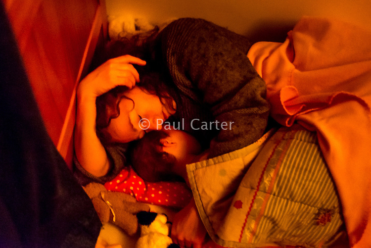 A woman breastfeeds her 20 month old daughter off to sleep at bedtime.<br /> <br /> 07/02/2013<br /> Hampshire, England, UK