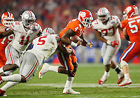 Clemson Tigers quarterback Deshaun Watson (4) runs through Ohio State Buckeyes linebacker Raekwon McMillan (5) during the third quarter of the Tigers' 31-0 win in the College Football Playoff semifinal Fiesta Bowl at University of Phoenix Stadium in Glendale, Arizona on Dec. 31, 2016. (Adam Cairns / The Columbus Dispatch)