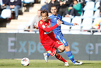 07.04.2012 SPAIN -  La Liga matchday 32th  match played between Getafe vs Sporting at Coliseum Alfonso Perez stadium (2-0). Picture show Oscar Guido Trejo and Mehdi Gregory (Midfielder of Getafe)