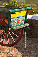 An old colourful and painted farm cart. Herdade da Malhadinha Nova, Alentejo, Portugal