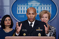 Surgeon General of the United States Jerome Adams, with members of the coronavirus taskforce, responds to a question from the news media during a COVID-19 coronavirus press conference at the White House in Washington, DC, USA, 14 March 2020. To date there are 2175 confirmed cases of COVID-19 coronavirus in the US with 50 deaths.<br /> Credit: Shawn Thew / Pool via CNP/AdMedia