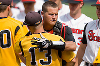 Joe Witkowski #9 of the St. John's Red Storm hugs Matt Leskiw #13 of the VCU Rams after the Red Storm eliminated the Rams 8-6 at the Charlottesville Regional of the 2010 College World Series at Davenport Field on June 5, 2010, in Charlottesville, Virginia.  Photo by Brian Westerholt / Four Seam Images