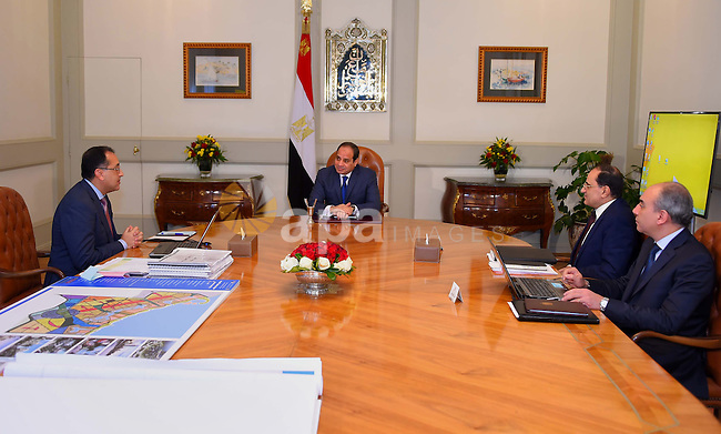 Egyptian President Abdel Fattah al-Sisi meets with Mustafa Madbouli, Housing Minister in Cairo, Egypt on January 3, 2017. Photo by Egyptian President Office