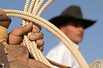 Lasso in a cowboy's hand, Minden Ranch Rodeo at the Douglas County fairgrounds in Gardnerville, Nevada.