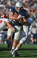 17 November 2012:  Penn State RB Zach Zwinak (28) runs through tackles by Indiana's Mark Murphy (37) and Greg Heban (9). The Penn State Nittany Lions defeated the Indiana Hoosiers 45-22 at Beaver Stadium in State College, PA.