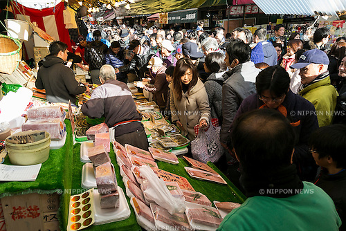 Members of staff sales their products along the streets of Ameyoko in Ueno on December 30, 2015, Tokyo, Japan. Ameya Yokocho, often called ''Ameyoko,'' is a narrow street market filled with more than 500 retailers and is a popular spot to buy groceries in preparation for the New Years, which is one of the most important holidays in Japan. (Photo by Rodrigo Reyes Marin/AFLO)